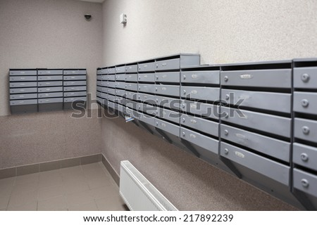 Boxes for letters are in the lobby of an apartment house - stock photo