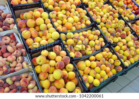Boxes of fresh Peaches in supermarket. Nature background