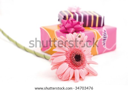 boxes of gifts and pink flower