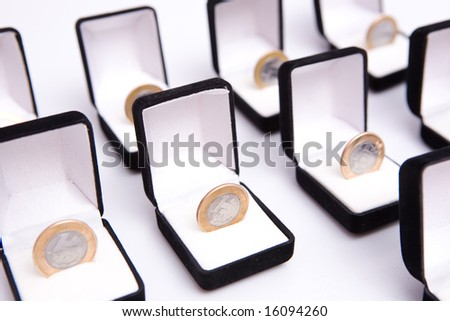 boxes of jewels with brazil real coin - stock photo