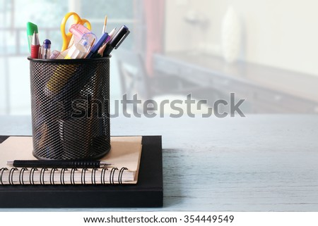 Boxes of school supplies and books on the table. - stock photo