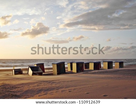 Boxes of wood at the beach in The Netherlands. - stock photo