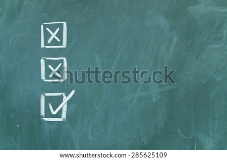 Boxes on green school chalkboard - stock photo