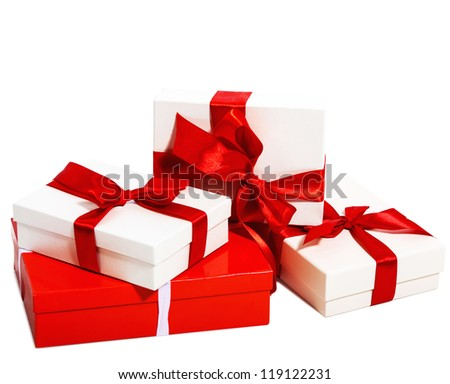 Boxes tied with a ribbon bow. A gift for Christmas, Birthday, Wedding, or Valentine's day. Isolated on white - stock photo