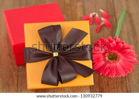 boxes with gerbera on the table