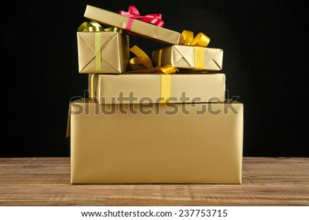 boxes with gifts on a black background - stock photo