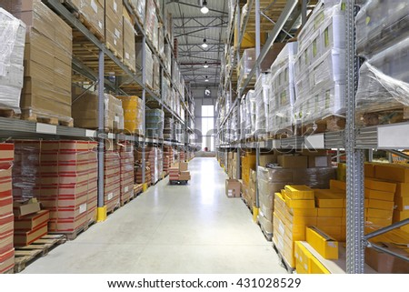 Boxes With Goods at Shelves in Warehouse - stock photo