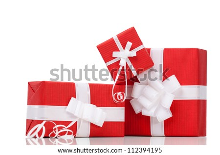 Boxes with xmas presents wrapped in red paper, isolated on white - stock photo