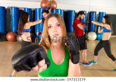 Boxing aerobox blond woman portrait in fitness gym training workout - stock photo