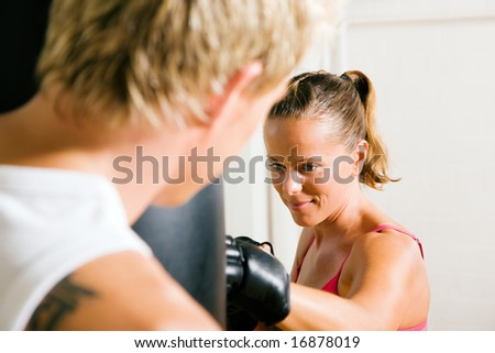 Boxing couple (male / female), trainer supervising the boxing student - stock photo
