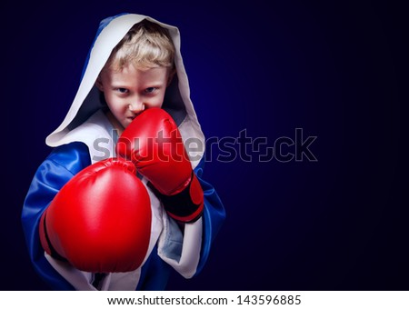 Boxing fighter boy portrait on dark blue background - stock photo