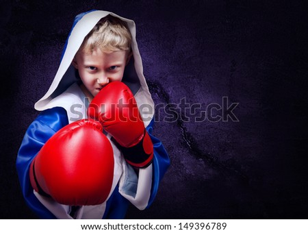 Boxing fighter boy portrait on the purple wall background - stock photo