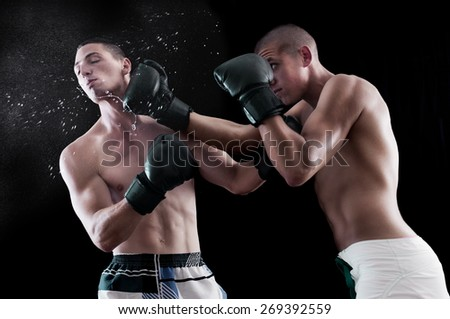 Boxing fighting in the ring - stock photo