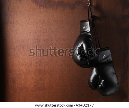 Boxing-glove hanging on grunge background - stock photo