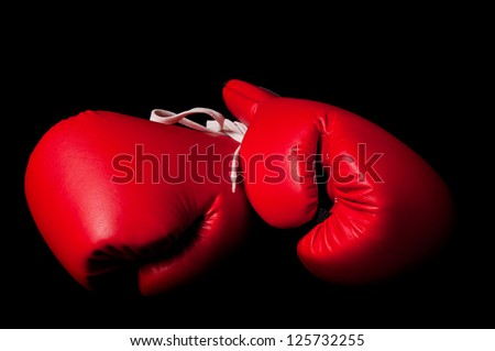 Boxing gloves against a black background - stock photo