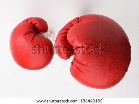 Boxing gloves against a white - stock photo