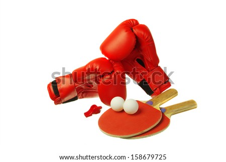 Boxing gloves and ping-pong rackets. White background