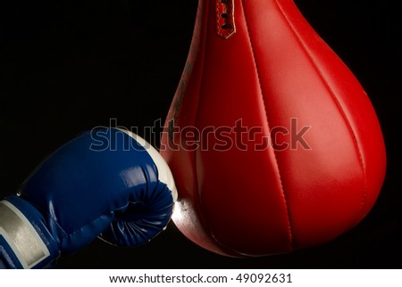Boxing gloves and punching bag. - stock photo
