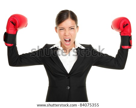 Boxing gloves business woman angry - business concept showing aggressive female businessperson flexing muscles wearing boxing gloves isolated on white background. Mad multiracial businesswoman. - stock photo