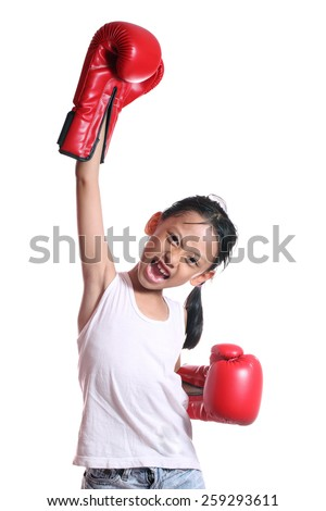 Boxing gloves girl - concept showing aggressive female  flexing muscles wearing boxing gloves isolated on white background. - stock photo