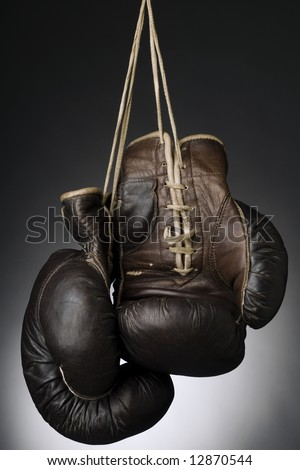 boxing gloves hanging by the string - stock photo