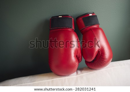 Boxing gloves on a green background.
