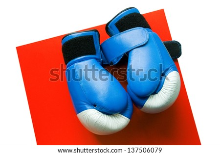 Boxing gloves on a red table