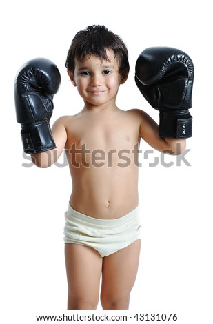 Boxing gloves on children hands - stock photo