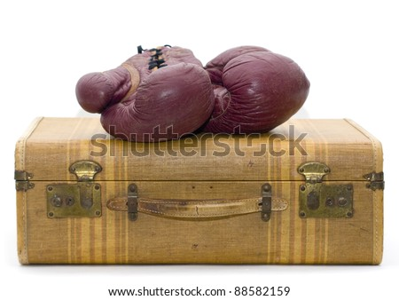 boxing gloves on luggage - stock photo