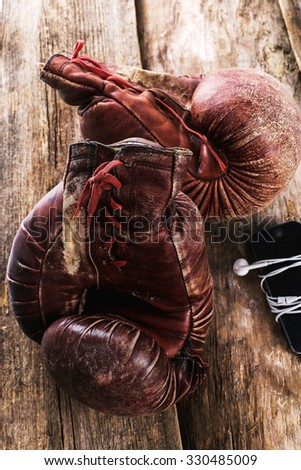 Boxing gloves on the wooden floor