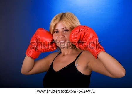 Boxing pose by attractive woman.