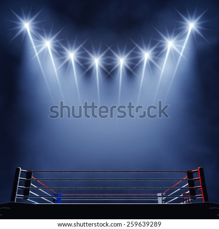 Boxing ring and floodlights , Fight night event