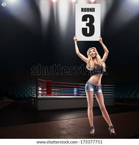 Boxing ring girl holding a board. High resolution