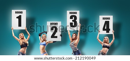 Boxing ring girls holding a board with round number isolated on blue background. set.  High resolution  - stock photo