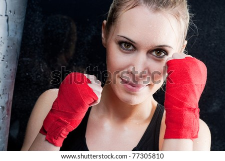 Boxing training blond woman sparring and sweating - stock photo