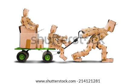 Boxman pulling a trolley with a family of boxkids and parcel - stock photo