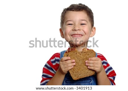 Boy aged five years with peanut butter and jelly sandwich on whole wheat bread, isolated on white background - stock photo
