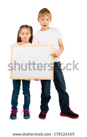 Boy and a girl hold a wooden frame with an empty copyspace, isolated - stock photo