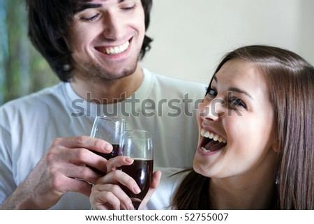 Boy and beautiful girl with wineglasses - stock photo