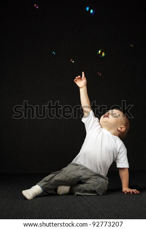 boy and bubbles - stock photo