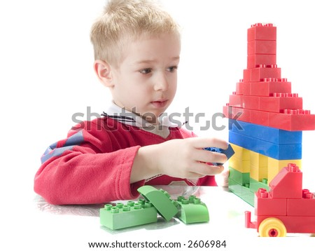 boy and building haus - stock photo