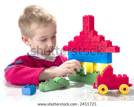 boy and building haus is block - stock photo