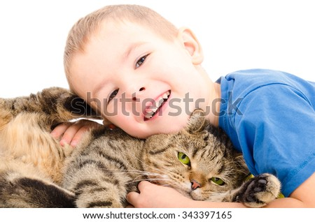 Boy and cat Scottish Straight hugging isolated on white background - stock photo