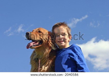 Boy and Dog in Blue Sky - stock photo