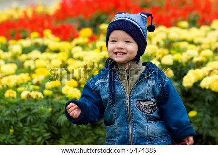 Boy and fowers - stock photo