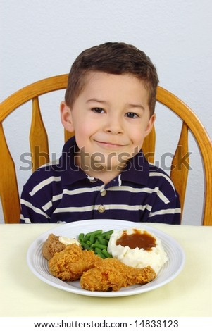 Boy and fried chicken dinner - stock photo