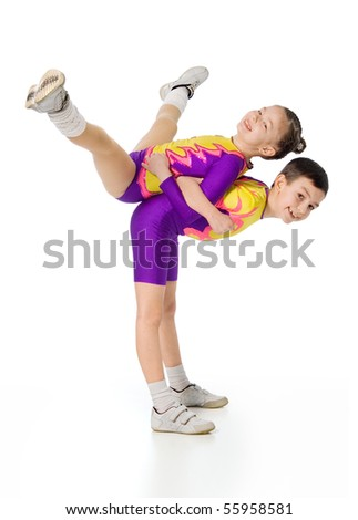 boy and girl acrobats.sporting exercise.image of athletes on a white background. aerobics - stock photo