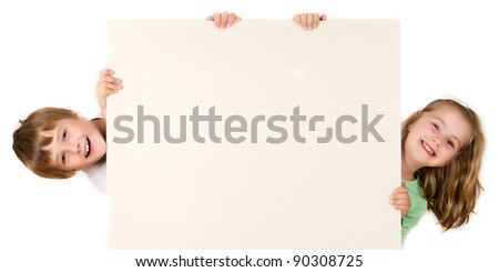 Boy and girl are holding empty  board on white - stock photo