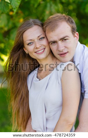 Boy and girl are hugging. Husband and wife on the nature