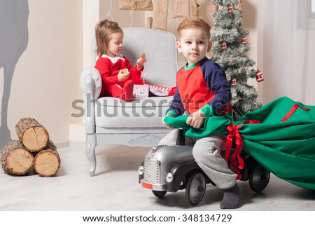 Boy and girl at Christmas eve - stock photo